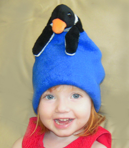 Rose sure looks cute in her new fleece penguin hat