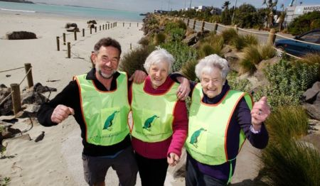 HI-VIS VESTS: Little blue penguin support group members in their new vests, which they wear when responding to questions from penguin viewers on the beach. Greg Adams and his mother Alwyn (right) and Margaret McPherson (center).